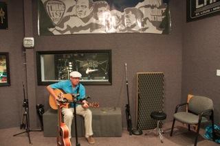 Neil performs at KCHX radio station